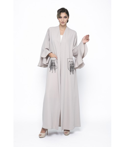 Beige ruffled abaya with patch pockets.