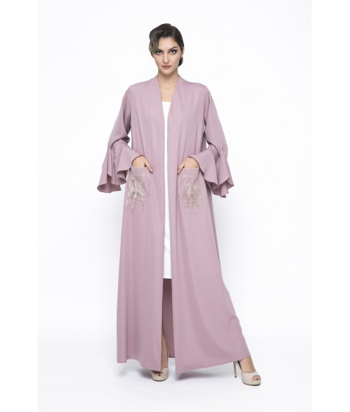 pink ruffled abaya with patch pockets.